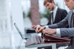 close up. businessman opening briefcase sitting at office Desk