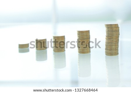 close up. businessman stacking coins in stacks on a glass table #1327668464
