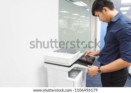 close up businessman use touchscreen of printer for scanning documents