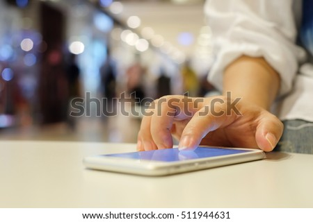 Shutterstock close up businesswoman hand swipe to unlock on smartphone touch screen for using application function inside device:mobile cellular connection:relaxing time:check to do list,read mailbox,news,report.