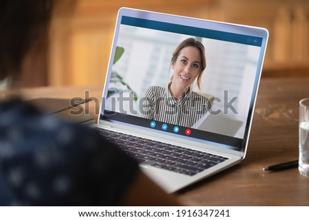 Close up businesswoman making video call, discussing project with colleague online, using laptop and webcam, student watching webinar or training, manager involved in conference, consulting client