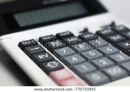 Close up button calculator ,  calculator  on table