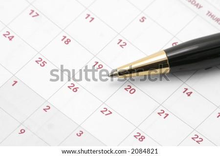 close up calendar and pen