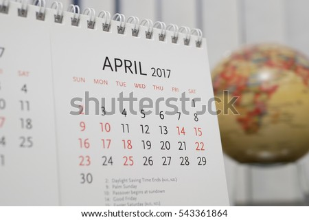Close up calendar of April 2017 with blur earth globe background #543361864