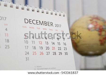 Close up calendar of December 2017 with blur earth globe background #543361837