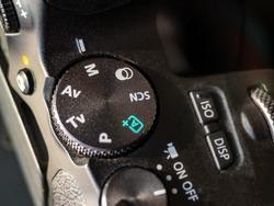close up camera mode dial. manuel mode selected mode dial