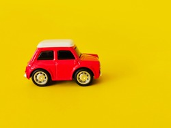 Close up car on yellow background