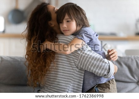 Close up caring young mother hugging preschool upset son. Lovely mom embracing and supporting child in difficult times. Stressful kid asking help from mum. Stock photo ©
