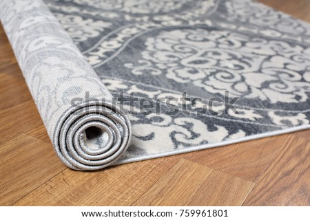 Close-up carpet on laminate wood floor in living room, interior decoration