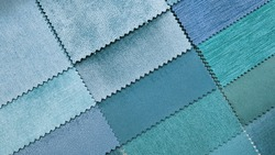 close up catalog of interior luxury fabric sample chart showing multi texture and pattern blue ,cyan and turquoise color tone. interior drapery and curtain samples palette.