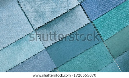 close up catalog of interior luxury fabric sample chart showing multi texture and pattern blue ,cyan and turquoise color tone. interior drapery and curtain samples palette. Stock photo ©