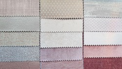 close up catalog of interior luxury fabric sample chart showing multi texture ,pattern and color tone. interior drapery and curtain samples in pink ,old rose ,red ,grey color palette.