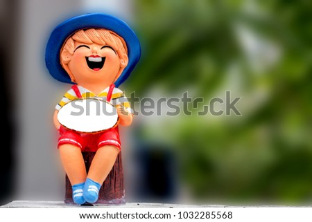 close-up. Ceramic smiling boy doll  with copy space.