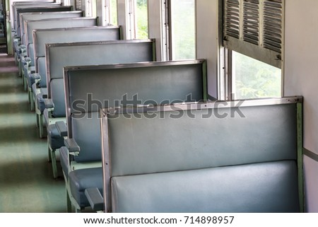 Close-up chair leather seats, empty seats, lonely, no passengers in the Thai train room during the day. #714898957