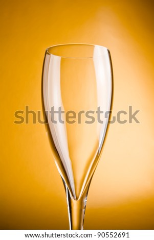 close up champagne glass on a golden background