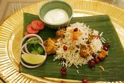 Close up Chicken Masala rice served with fresh yogurt