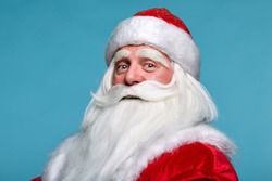 Close-up christmas face portrait of russiad Santa Claus Ded Moroz. White-haired elderly man with white beard and moustache looking in camera.