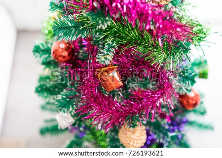 Close-up christmas tree with red bauble hanging from a decorated and light bokeh. concept of merry christmas and happy new year. Xmas background. #726193621
