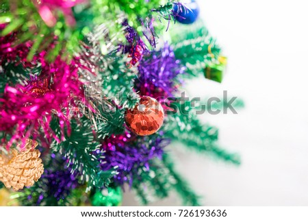Close-up christmas tree with red bauble hanging from a decorated and light bokeh. concept of merry christmas and happy new year. Xmas background. #726193636