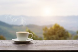 Close up coffee espresso on wood table nature background in garden,