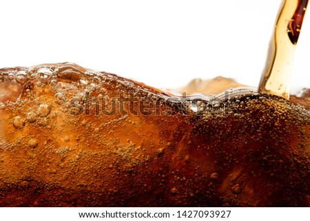 Close up cola pouring with ice and bubble in glass on white background cold drink beverage #1427093927