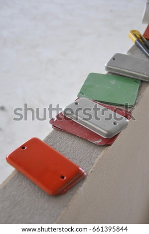 Close up colored junction box steel cover for marking which wiring inside these box such as LAN wire, Telephone wire, CCTV wire and electric wire #661395844