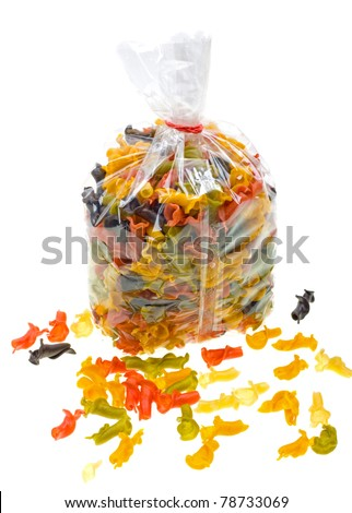 Close-up colored pasta in packaging bag isolated on white background