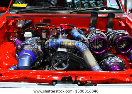 Photo of  Close up colorful details of car engine. Modification of the turbo engine