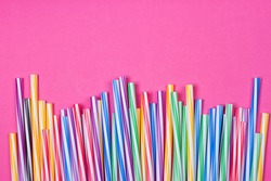 close-up colorful fancy drinking straws, fancy tube for party on the pink background