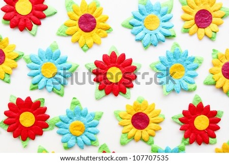 Close up colorful paper flowers