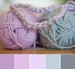 Close up colorful yarn texture background, violet lavender pink and gray strains. Shallow depth of focus. Color palette swatches, fresh trendy combination of colors for styling, pastel nuances.