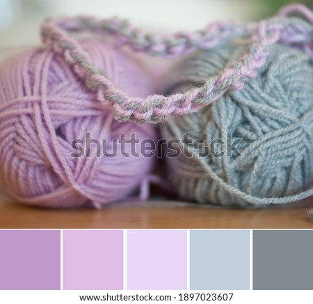 Close up colorful yarn texture background, violet lavender pink and gray strains. Shallow depth of focus. Color palette swatches, fresh trendy combination of colors for styling, pastel nuances. Photo stock ©