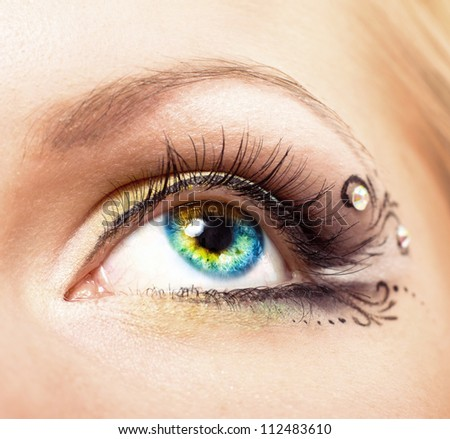 Close up Colourful human eye with makeup. Beauty and fashion - stock photo