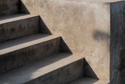 Close up concrete stair with shading.