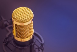 Close-up condenser gold microphone with luxury. Composition on the left side with free space on the right. Artistic style.