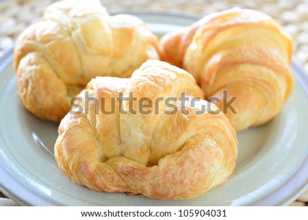 close-up continental breakfast with fresh croissant, coffee