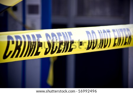 Close up crime scene investigation police boundary tape - Shutterstock ID 16992496