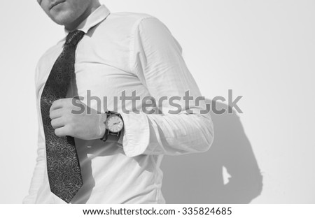 Close up crop young man body in casual fashion hipster stylein glasses in black and white