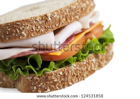 Close-up cropped image of delicious ham sandwich isolated on a white background
