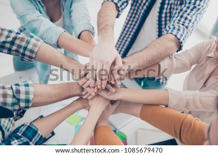Close up cropped top high angle view portrait of pile stack of business people's palms putting on top of each other, progress, connection, handshake, agreement, achievement, harmony concept #1085679470