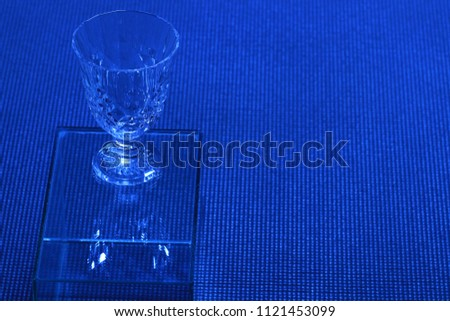 Close up Crystal glass on blue background