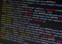 Close up css code on monitor screen with black background