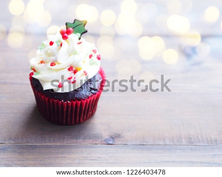 Close up cupcake with christmas tree shape on wooden table. Christmas and new year holidays background concept.