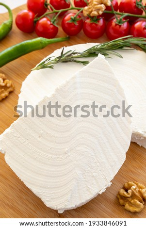 Close-up curd cheese on wooden background. Local name lor peyniri Stok fotoğraf ©