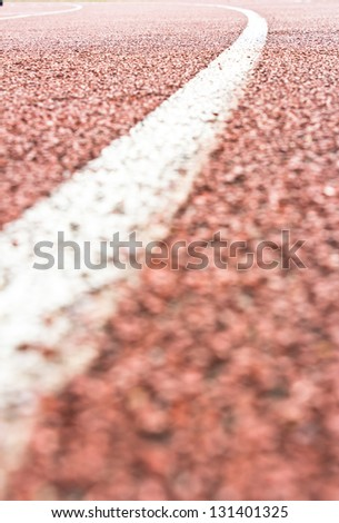 Close up curve running track rubber standard red color