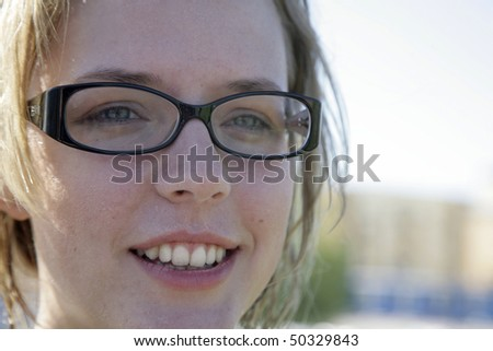 Close-up cute girl wearing glasses