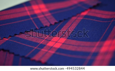 close up dark blue and red scott pattern fabric of shirt, photo shoot by depth of field for object #494532844