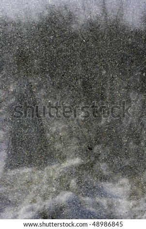 Close-up dark marble stone texture to background