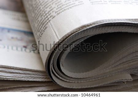 close up detail of a folded newspaper