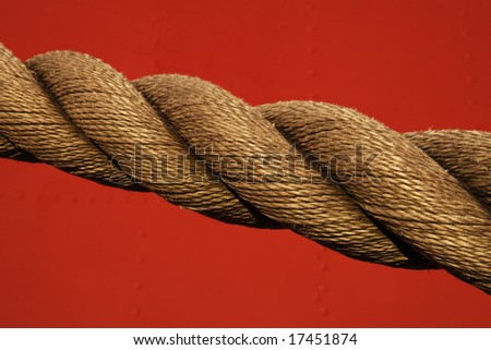 Close up detail of a heavy rope being used to moor a large for Heavy rope for nautical use